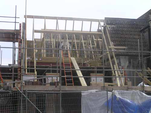 3/6/08 The roof timbers continue to take shape.
