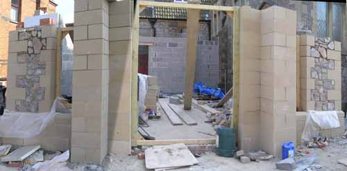 8/5/08 The doorway and windows start to take shape.